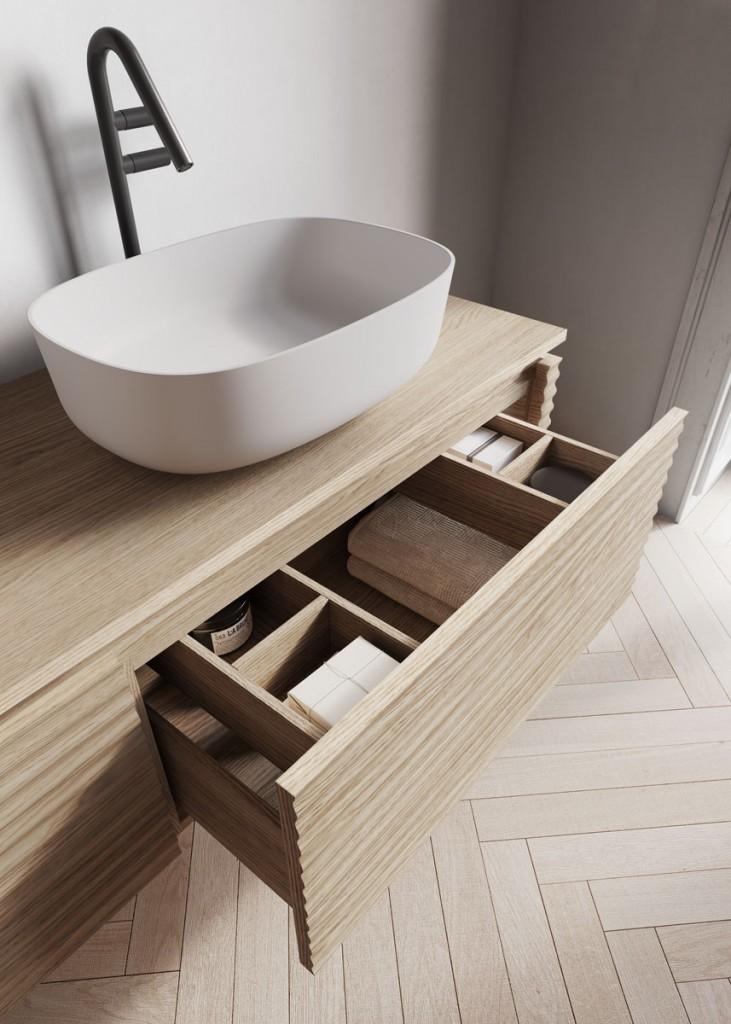 Dettaglio lavabo d'appoggio e cassettone scorrevole